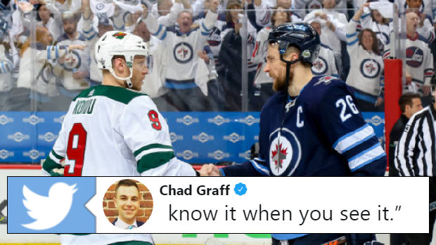 Minnesota Wild captain Mikko Koivu shakes hands with Winnipeg Jets captain Blake Wheeler.